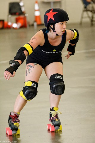 You see JC LAU playing rollerderby like a champ.