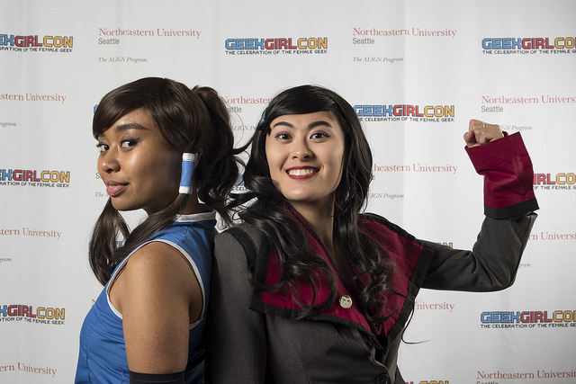Two women in cosplay pose in the GeekGirlCon '17 photobooth.