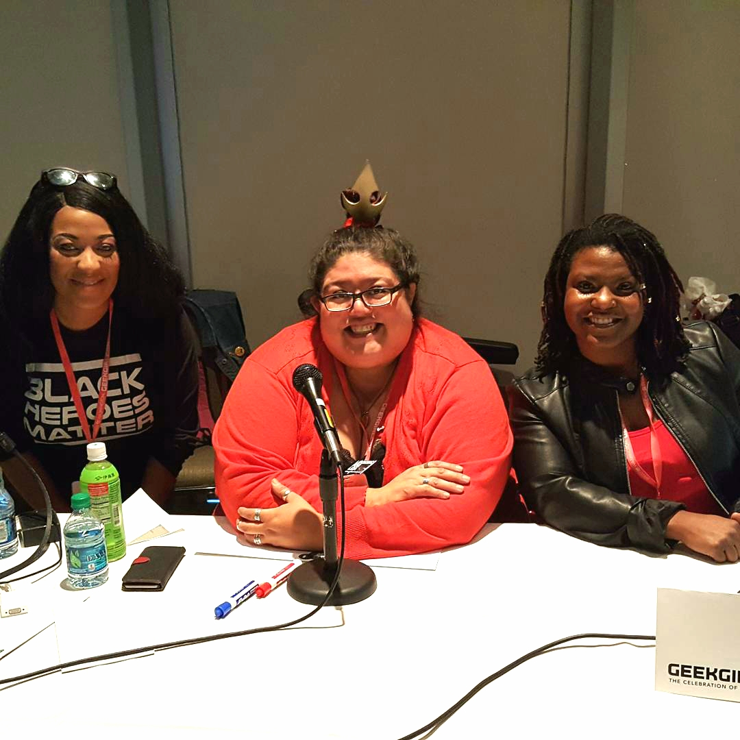 Source: me. Description: panelists Isabella L. Price, Kristine Hassell, and Raisha K. smiling for the camera while seated behind a table.