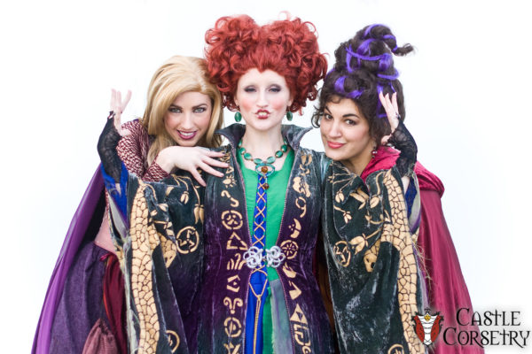 Three women dressed as the witches from Hocus Pocus in costumes designed by Castle Corsetry