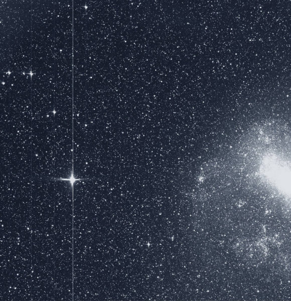 A black and white image of a star and a galaxy from the Transiting Exoplanet Survey Satellite.