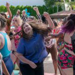 "Characters dancing during the iconic pool party scene from ""Shrill."" Source: Vulture"